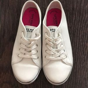 White Sperry sneakers